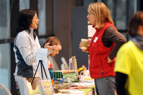 Faye Ogaswara of Slow Food Huron Valley and Carole Durgy of Project Health Schools/UMHS chat during the Homegrown Local Food Summit in the atrium at the Morris J. Lawrence Building at Washtenaw Community College on Friday, Feb. 22, 2013. Melanie Maxwell I AnnArbor.com